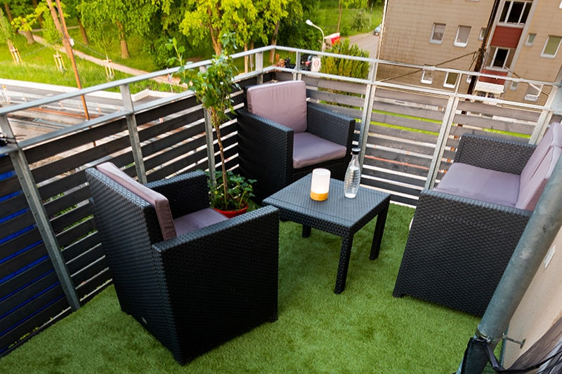 Ground floor balcony design with edge to edge artificial grass