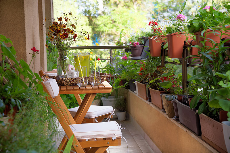 Balcony decoration images for your home where even the smallest of balconies can accommodate a pretty little flower garden for condo balcony decor