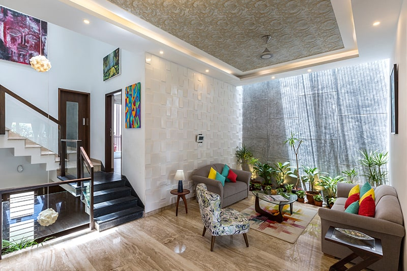 Living room ceiling design with wallpaper to make a cool statement by extending it to fifth wall