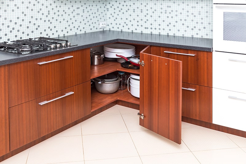 Corner kitchen cupboard to make optimum use of corner spaces, it's a very good space saving kitchen cupboard design ideas
