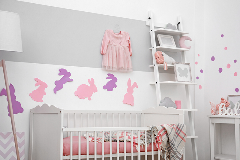 Designer nursery with rabbit designed with a ladder by nursery designers
