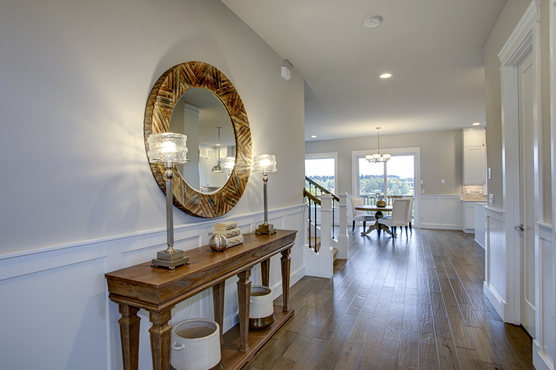 Flat entrance design with a handsome mirror on the top of a console table for foyer design ideas