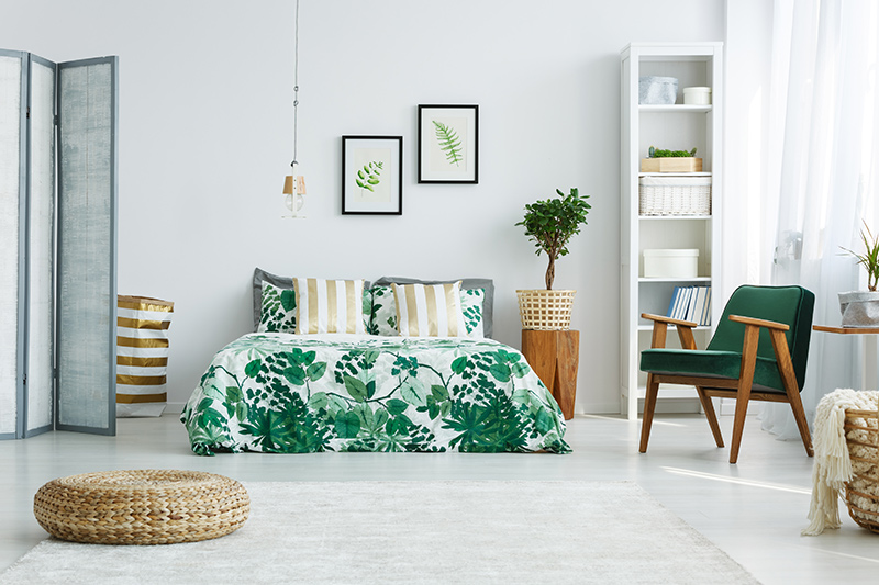 Interior decoration of bedroom with a combination of tropical footprints and pillow covers for bedroom  decoration