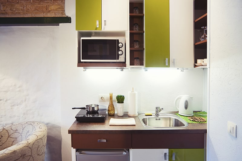 Kitchenette with the modern conveniences of sink, stove, fridge and oven