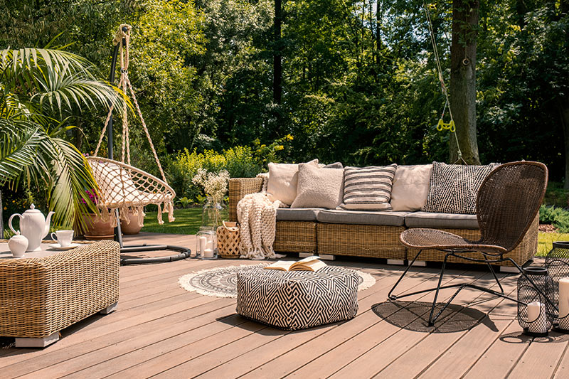 Living room outdoor design with a rattan sofa and table to make a beautiful outdoor