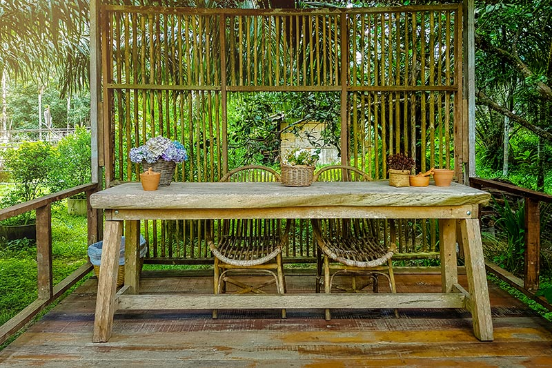 Outdoor designs by using natural materials and textures such as bamboo wall