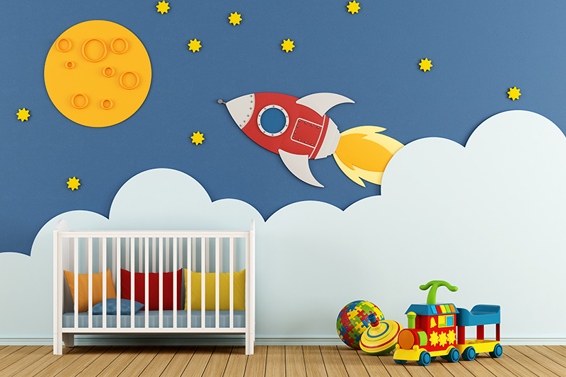 Nursery wall design with a rocket and sun printed on the wall with best nursery designs