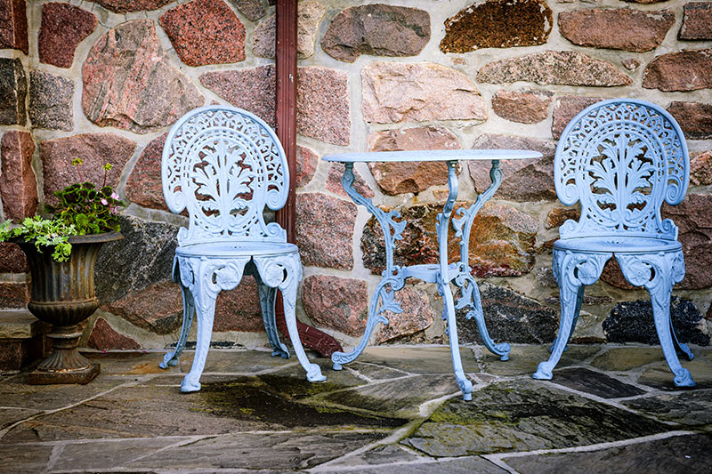 Home outdoor design with a finely wrought of table and chairs