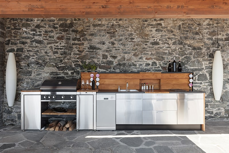Modern outdoor kitchen designs by converting a section of your outdoors space into a kitchen