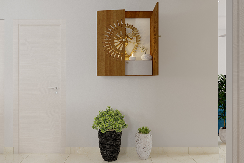 Pooja ghar vastu where the pooja unit is fit into the wall in a small cabinet for pooja room vastu