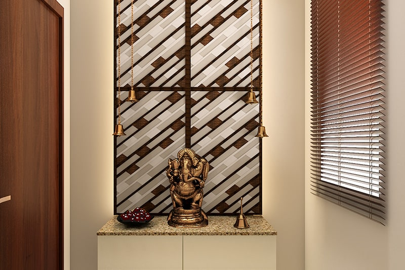 Simple pooja unit design with simple, traditional bells for decor for pooja room designs