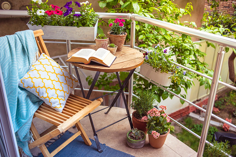 Small balcony decorating ideas on a budget where great idea for balcony decoration is a designated reading corner which teaches you ways to decorate balcony