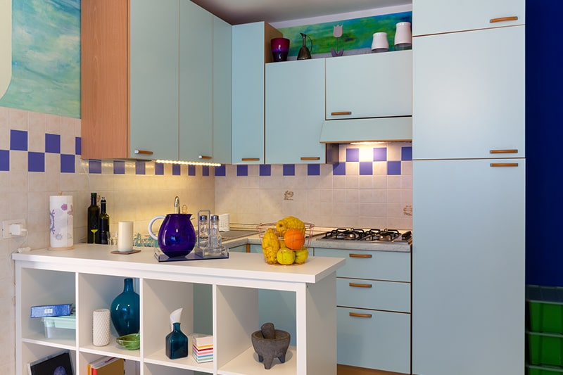 Small kitchenette lights are installed under the cabinet and over the hob