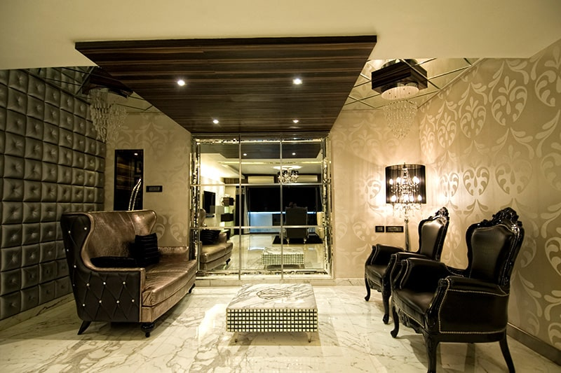 Wallpaper designs for living room wall with a upholstery to make elegant look