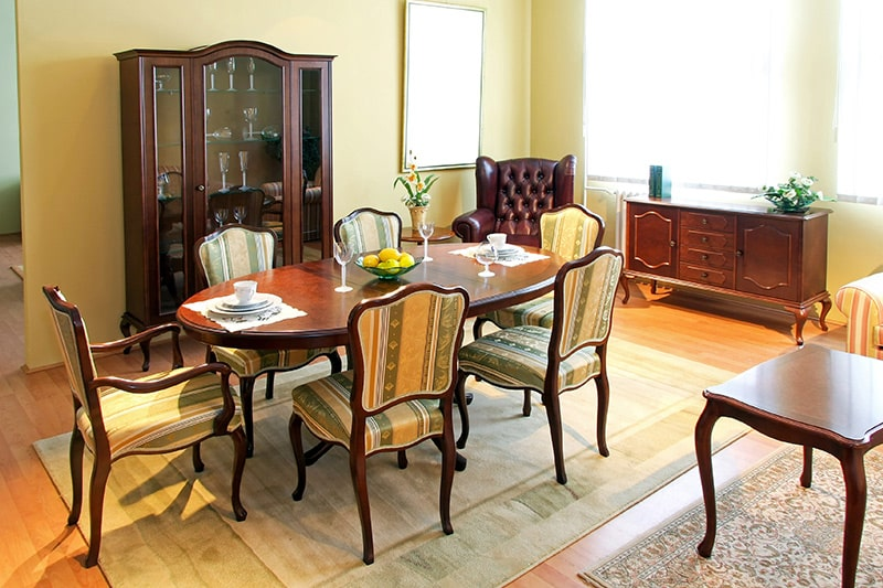Vintage wooden dining table with elegant decor gives modern wooden dining table