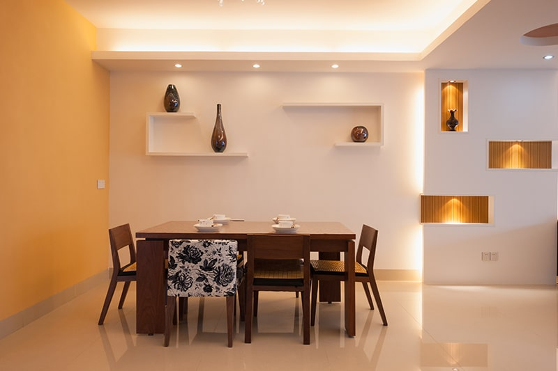 Wooden dining table design with assorted chairs add uncommon touch to your dining room interiors