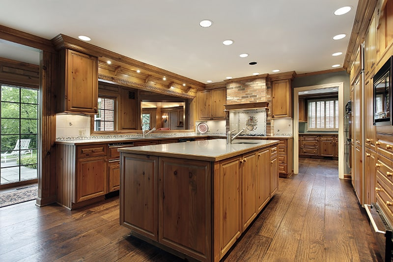 Wooden kitchen cupboard designs gives a traditional look to your kitchen cupboards