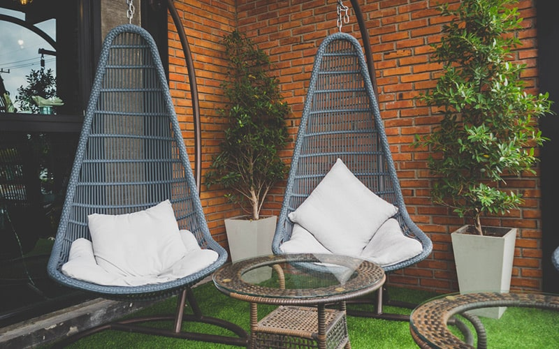 Swings and hammocks are popular for elegant outdoor balcony furniture