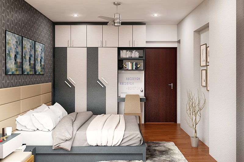 Designer wardrobe door design looks contemporary and comes with an attached bookshelf and study table