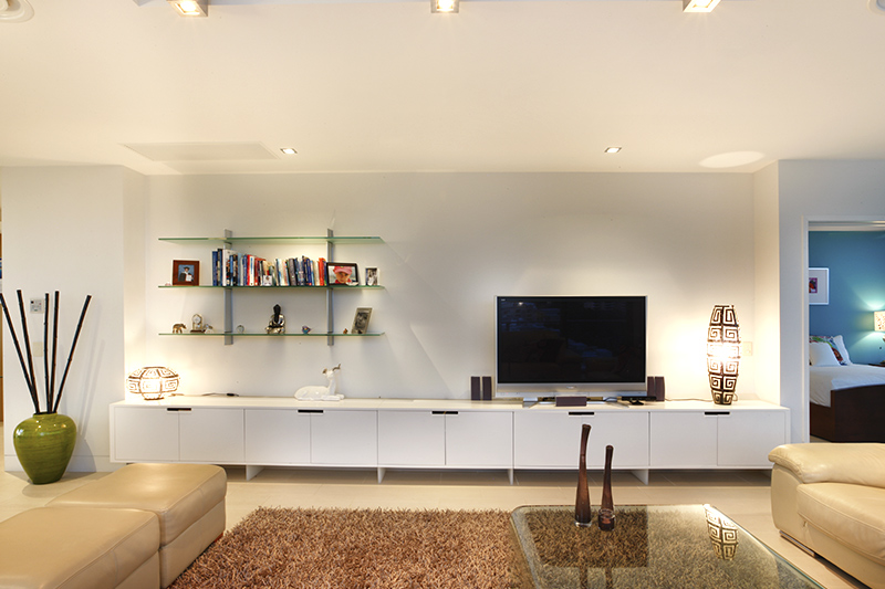 Living room shelves where a transparent material that blends seamlessly into the environment for a light of glass shelves for living room