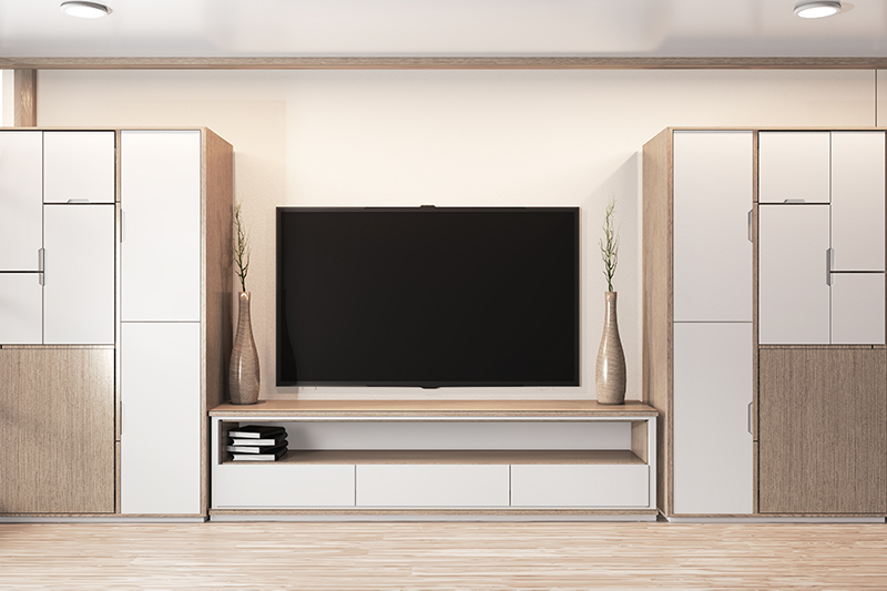 tv stand wardrobe design that comes with identical wardrobes on the side and a ledge-cum shelf at the bottom.