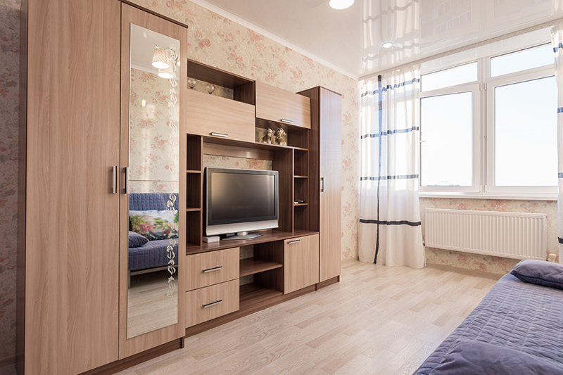 wardrobe design with tv which serves as the perfect backdrop for your screen
