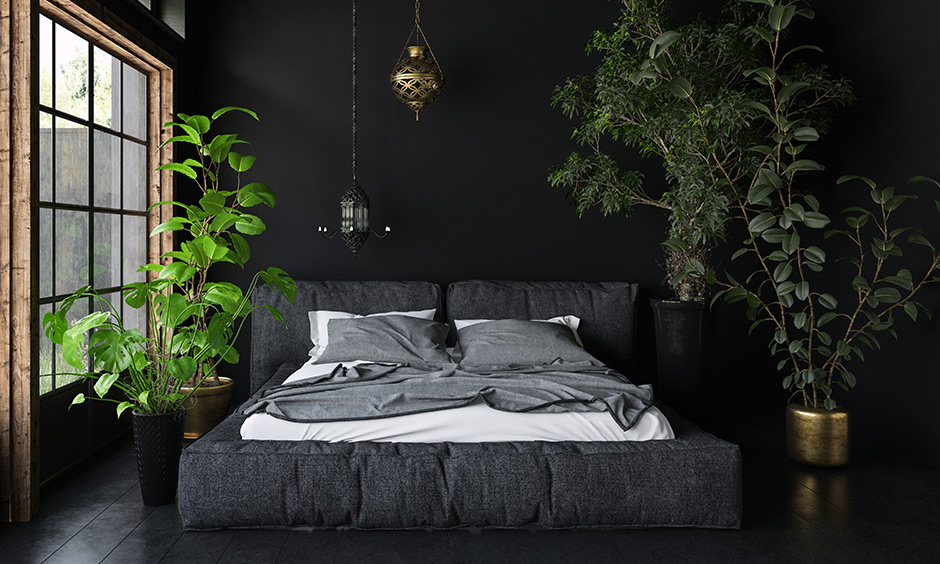 Black marble floor tiles for your home in a dark bedroom with dark sheets with solid black tile flooring