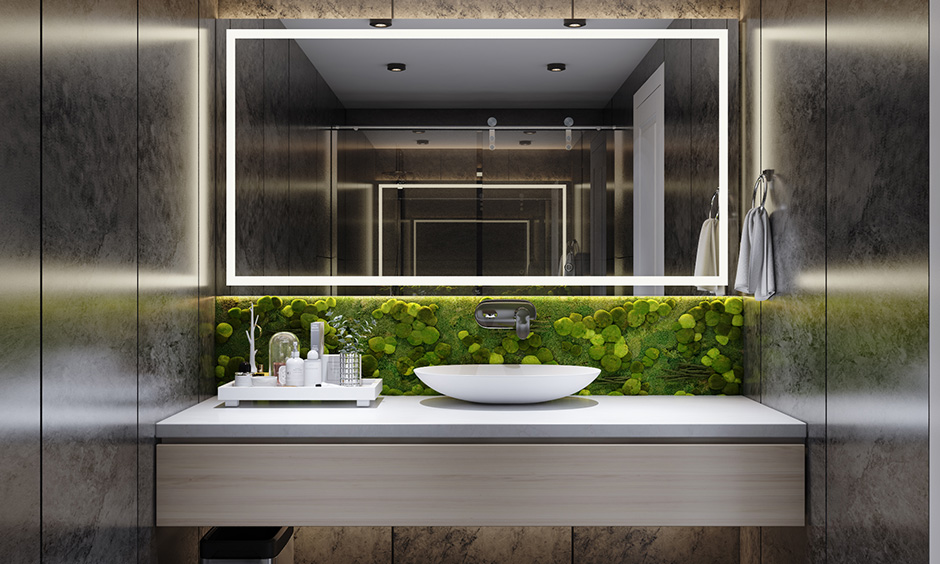 Black bathroom wall paint with a plant wall and the warm glow of focused lighting binds the space together seamlessly.