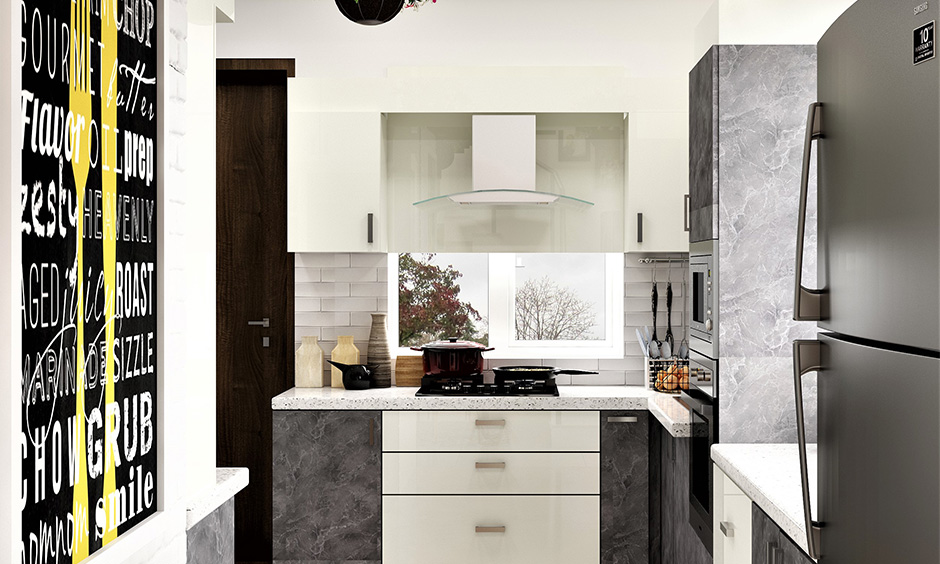 Curved glass elegant kitchen chimney enhances the overall vibe of the kitchen and creates visual drama.
