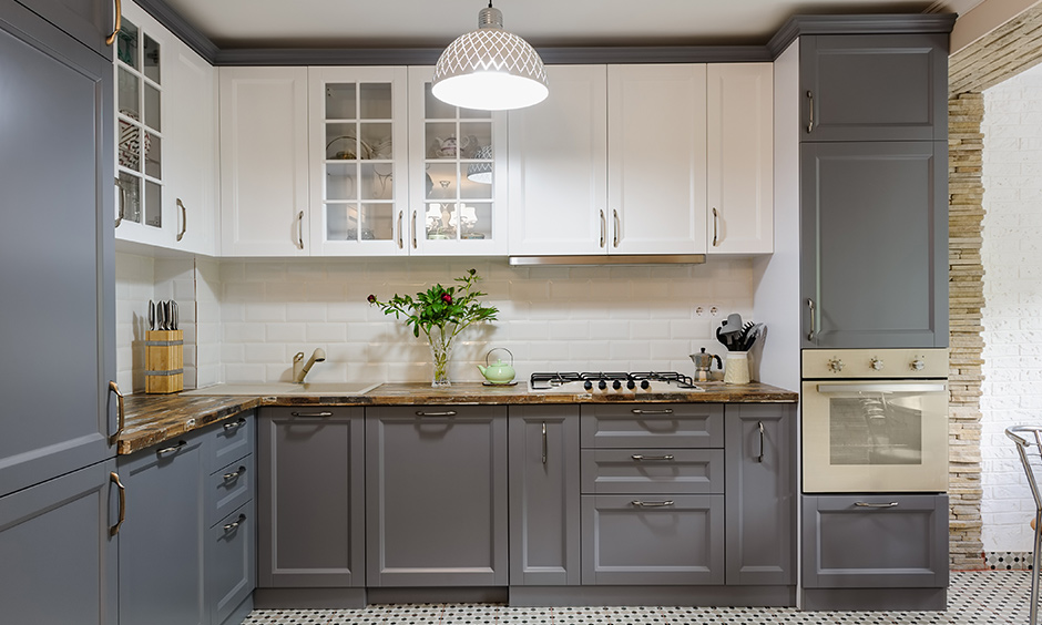Grey and white kitchen cabinets will make your white kitchen look elegant, clean and contrast well.