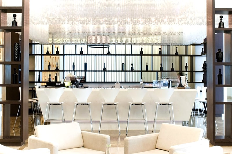 Home bar designs by adding personalised bar mirrors gives you modern home bar designs