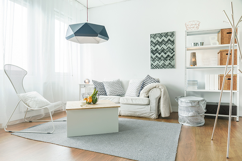 Simple modern living room needs to be airy, fresh and uncluttered with a few pieces of  mindfully chosen furniture.