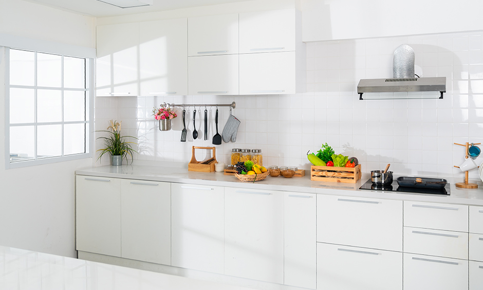 Modular kitchen chimney design with a duct is the perfect choice for your kitchens with minimalistic interiors.