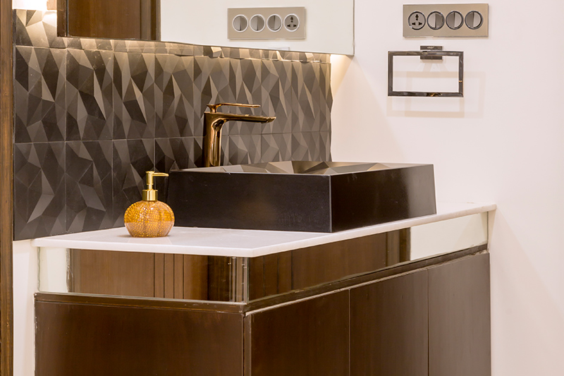 New trends in home decor with a wash basin made up of brass and bronze with dull gold tap