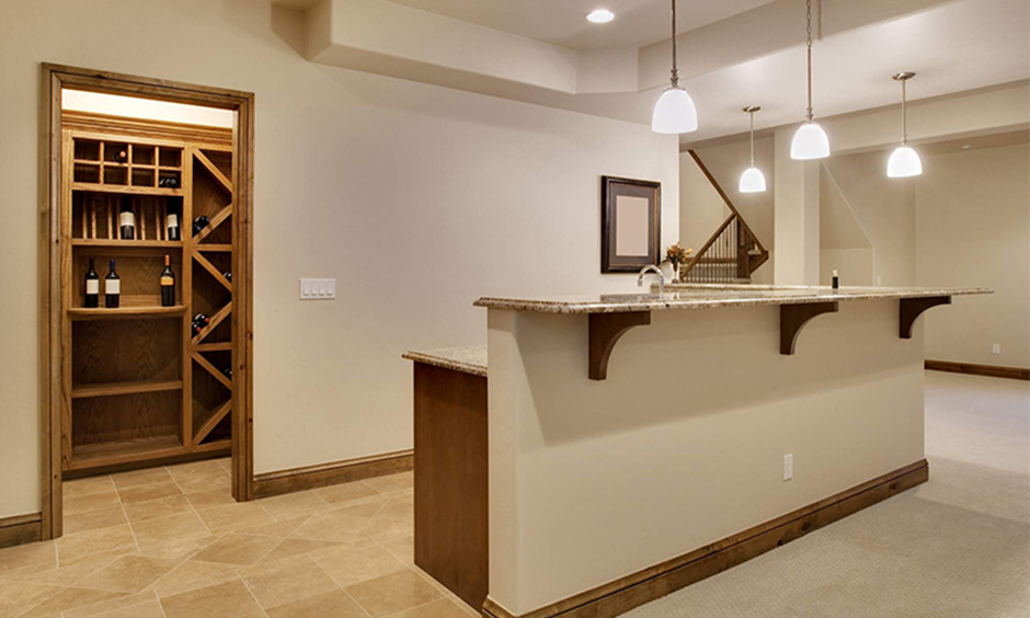 Tall home bar cabinet enclosed within a pantry with lots of space to store all your wine whisky rum and more.