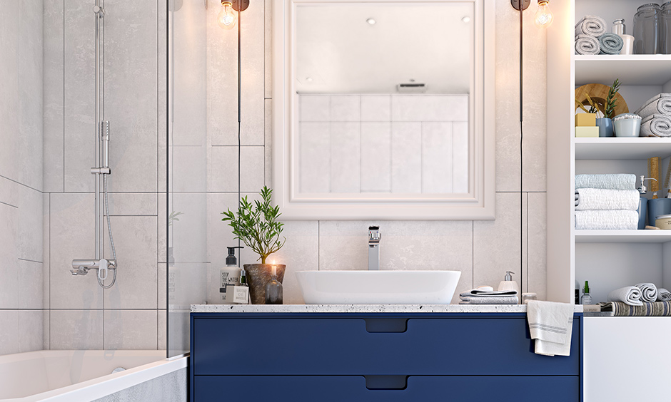 White and Navy bathroom colors make space an elegant and refreshing to look at.